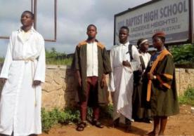 Christian students wore religious clothes over their school uniforms
