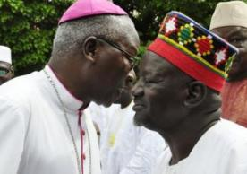 The Archbishop of Ouagadougou wishes a traditional chief a happy Eid